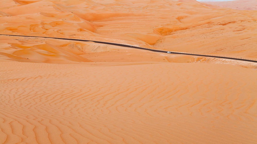 Desert Photography captures a car driving through the sand